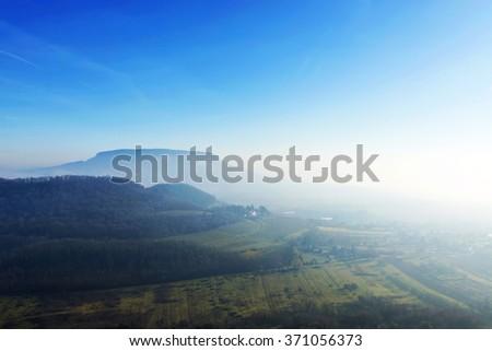 Badacsony in the foggy morning at Lake Balaton, Hungary - stock photo