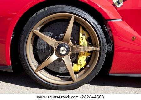 BADAJOZ, SPAIN - MARCH 14, 2015: Ferrari Car show at Badajoz City on Complejo Alcantara resorts, March 14, 2015. Detail image showing the wheel of a Ferrari Laferrari - stock photo