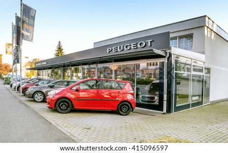 BADEN-BADEN, GERMANY - MAY 2: Office of official dealer Peugeot.  Peugeot is a major French automobile manufacturer, part of the PSA Peugeot Citroen group,  Germany, Baden-Baden, May 2, 2016 - stock photo