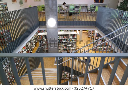 BADEN-BADEN, GERMANY - SEPTEMBER 23: Interior Public Library in Baden-Baden.  The City Library Baden-Baden was on 1 April 1901 as a people's library with reading room. - stock photo