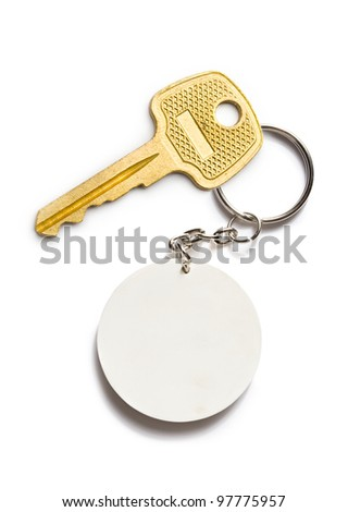 Badge and key on the white background - stock photo