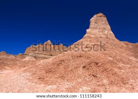 Badlands National Park of South Dakota is a rugged landscape of eroded rock - stock photo