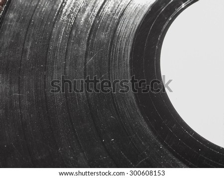 Badly damaged scratched vinyl record vintage analog music recording medium - stock photo