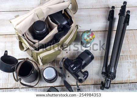 Bag and appliances for photography top view - stock photo