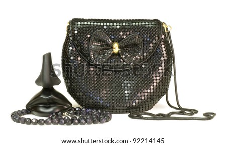 Bag and  perfume in a black bottles on white background - stock photo
