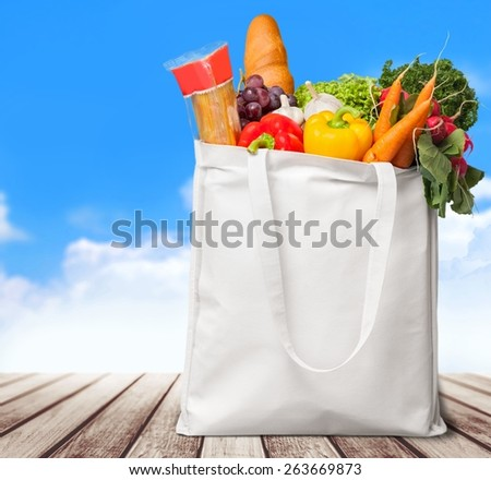 Bag. Healthy foods to buy / studio photography of brown grocery bag with fruits, vegetables, bread, bottled beverages - isolated over white background - stock photo