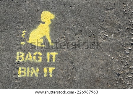 Bag it and Bin it sign printed on a path, to encourage cleaning up after your dog.. - stock photo