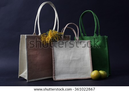 bag made out of natural eco recycled Hessian sack with apple, rye and flowers - stock photo