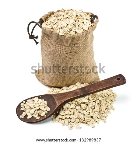 bag of oats and a wooden spoon on a white background. keeping paths - stock photo