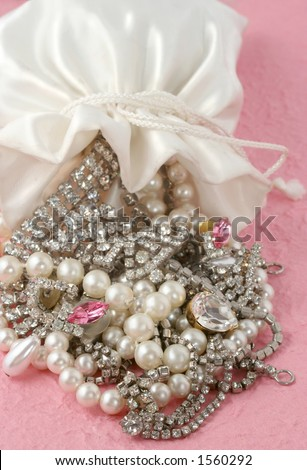 bag spilled over with jewels falling out - stock photo