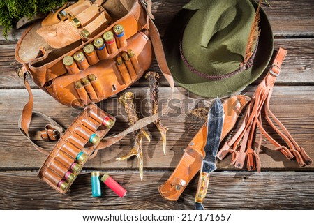 Bag with bullets in a hunting lodge - stock photo