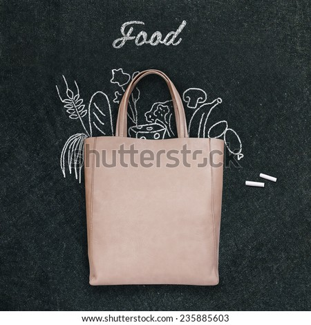bag with drawn  food on a chalk board - stock photo