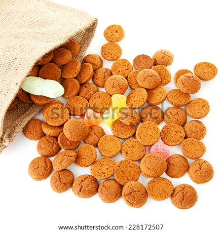 bag with typical dutch sweets: pepernoten (ginger nuts) for a celebration at 5 december in the Netherlands over white background - stock photo