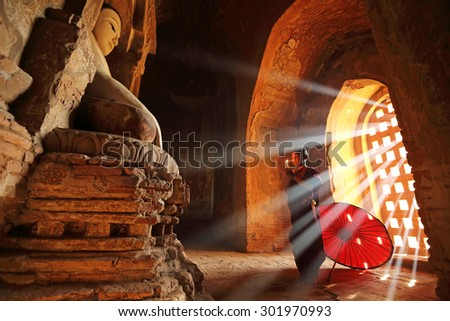 BAGAN, MYANMAR - DEC 6, 2014: Unidentified Buddhism neophyte prays in Buddihist temple on December 6, 2014 in Bagan, Myanmar. Southeast Asian neophyte praying in a Buddihist temple - stock photo