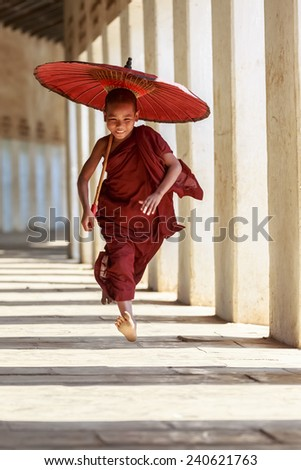BAGAN, MYANMAR - DEC 6: Unidentified young Buddhism novice at Shwezigon temple on Dec 6, 2014 in Bagan. Buddhism is predominantly of the Theravada tradition, practised by 89% of the population. - stock photo