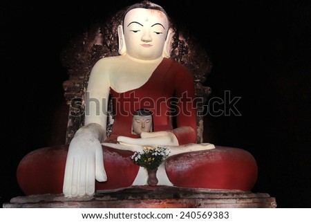 BAGAN, MYANMAR, December 10, 2014 : Two heads Buddha in a Bagan pagoda.  Bagan Archaeological Zone is a main draw for the country's tourism industry and is seen as equal in attraction to Angkor Wat. - stock photo