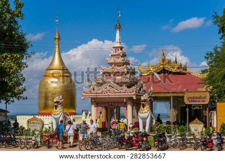 BAGAN, MYANMAR - NOVEMBER 20: Many visitors of the Bagan Temples go around with bicycles as can be seen at the gates of the famous Buphaya Temple. November 20, 2014 in Bagan, Myanmar. - stock photo