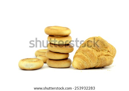 bagel and croissant on a white background - stock photo
