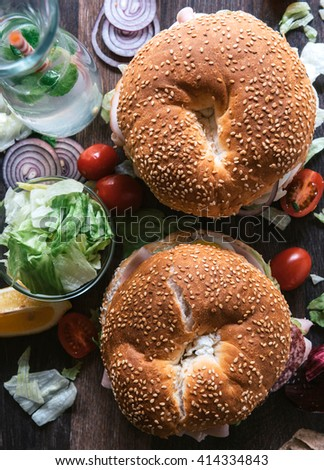 Bagel sandwich with turkey breast from high angle,selective focus - stock photo
