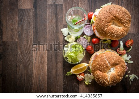 Bagel sandwiches with turkey breast and vegetables,selective focus and blank space - stock photo