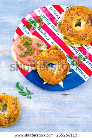 bagel  with a smoked salmon and cream cheese. selective focus - stock photo