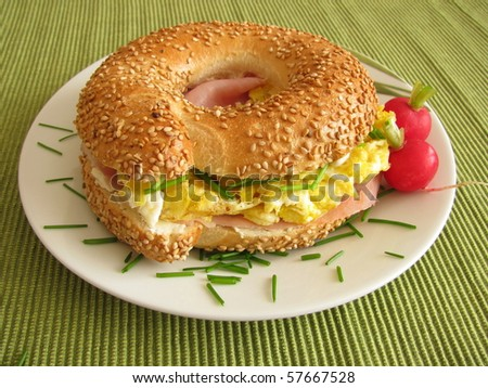 Bagel with ham and egg - stock photo