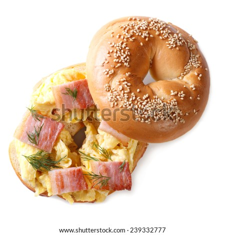 bagel with scrambled eggs and bacon closeup isolated on white background  - stock photo