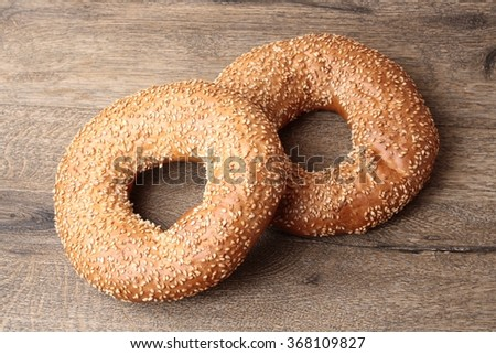 bagel with sesame seeds and milk - stock photo