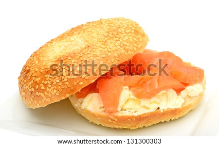 Bagel with smoked salmon and soft cheese  on plate - stock photo