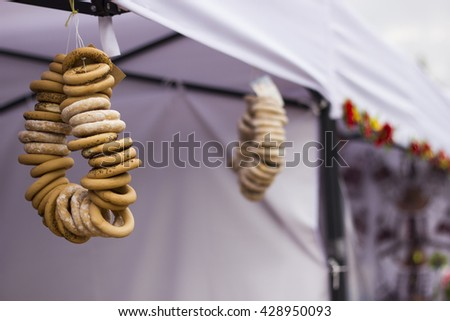 Bagels on a bunch hanging on the counter in the sale at the fair. - stock photo