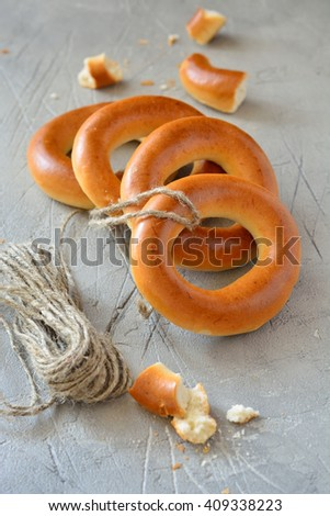 Bagels round table on gray concrete close up - stock photo