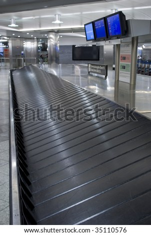 Baggage carousel at the airport. Baggage claim. - stock photo