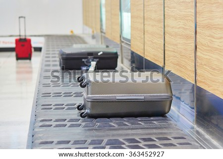 Baggage on conveyor belt at the airport  - stock photo