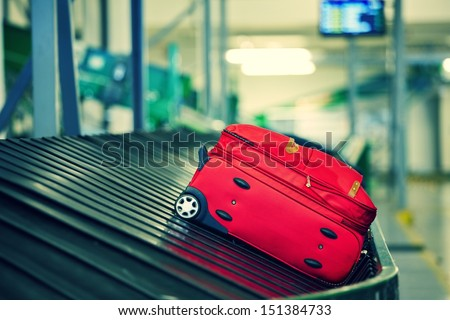Baggage on conveyor belt at the airport - selective focus - stock photo