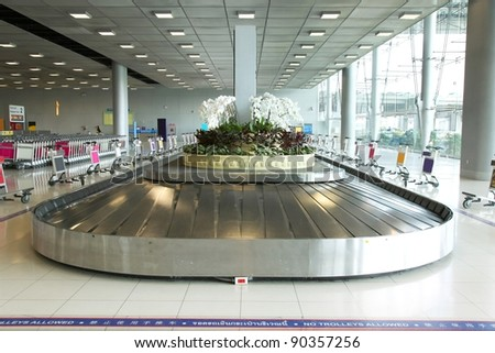 Baggage pickup carousel at the Suvarnabhumi airport ,Bangkok Thailand - stock photo