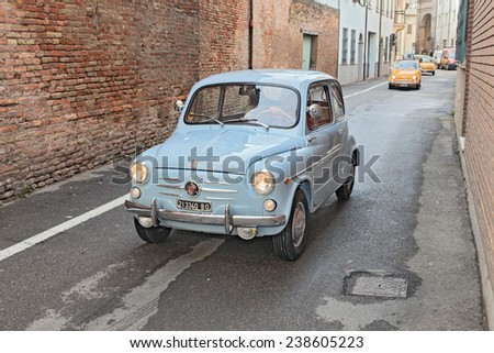 "BAGNACAVALLO, RA, ITALY - NOVEMBER 9: driver on a vintage Italian car Fiat 600 in classic cars rally during the feast ""Sagra dei sapori d'autunno"" on November 9, 2014 in Bagnacavallo, RA, Italy  - stock photo"