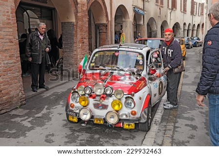 """BAGNACAVALLO, RA, ITALY - NOVEMBER 9: driver with a vintage custom car Fiat 500 F in classic cars rally during the feast """"Sagra dei sapori d'autunno"""" on November 9, 2014 in Bagnacavallo, RA, Italy  - stock photo"""