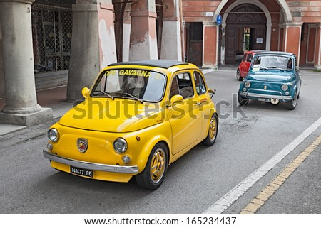 """BAGNACAVALLO, RA, ITALY - NOVEMBER 10: unidentified driver on a yellow vintage car Fiat 500 Abarth in the rally """"Meeting Fiat 500"""" on November 10, 2013 in Bagnacavallo, RA, Italy  - stock photo"""