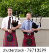 Bagpipe duo in full dress including kilt, playing in Ottawa, Canada. - stock photo
