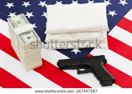 Bags full of drug stack of money and handgun on american flag - stock photo