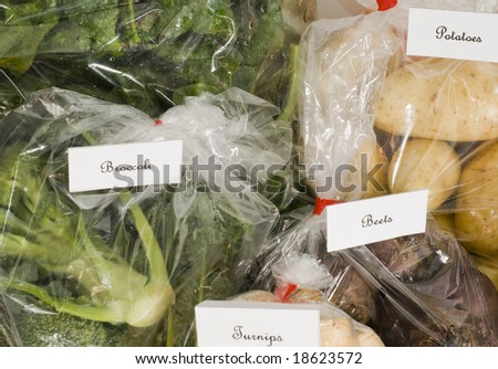 Bags of fresh produce from a Farmers Market - stock photo