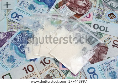 Bags with drugs on the background of polish money - stock photo