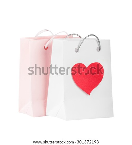 Bags with pink heart for purchases on the white - stock photo