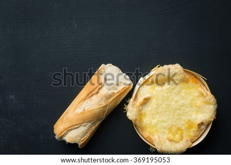Baguette and baked Cheese - stock photo