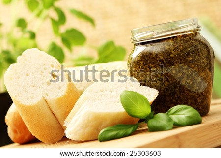 baguette and jar of pesto - delicious snack - food and drink - stock photo