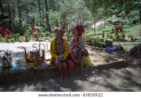 BAGUIO, THE PHILIPPINES - FEBRUARY 14: Ifugao people in the city at February 14, 1997 in Baguio, The Philippines. The Ifugao is a tribe living in Luzon Island. Their number is very small now. - stock photo