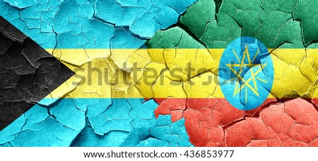 Bahamas flag with Ethiopia flag on a grunge cracked wall - stock photo