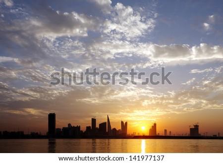 Bahrain skyline and beautiful sunset - stock photo