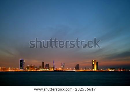 Bahrain skyline and the dark cloud during dusk  - stock photo