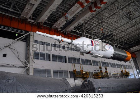 BAIKONUR, KAZAKHSTAN - DECEMBER 18, 2011: Part of Soyuz spacecraft is being relocated in Integration facility building for further assembly - stock photo